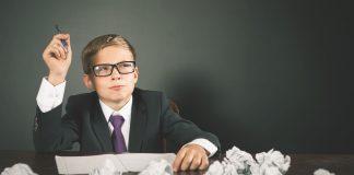 school boy brainstorming ideas for essay writing