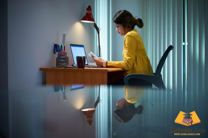 Girl writing expository essay on study desk