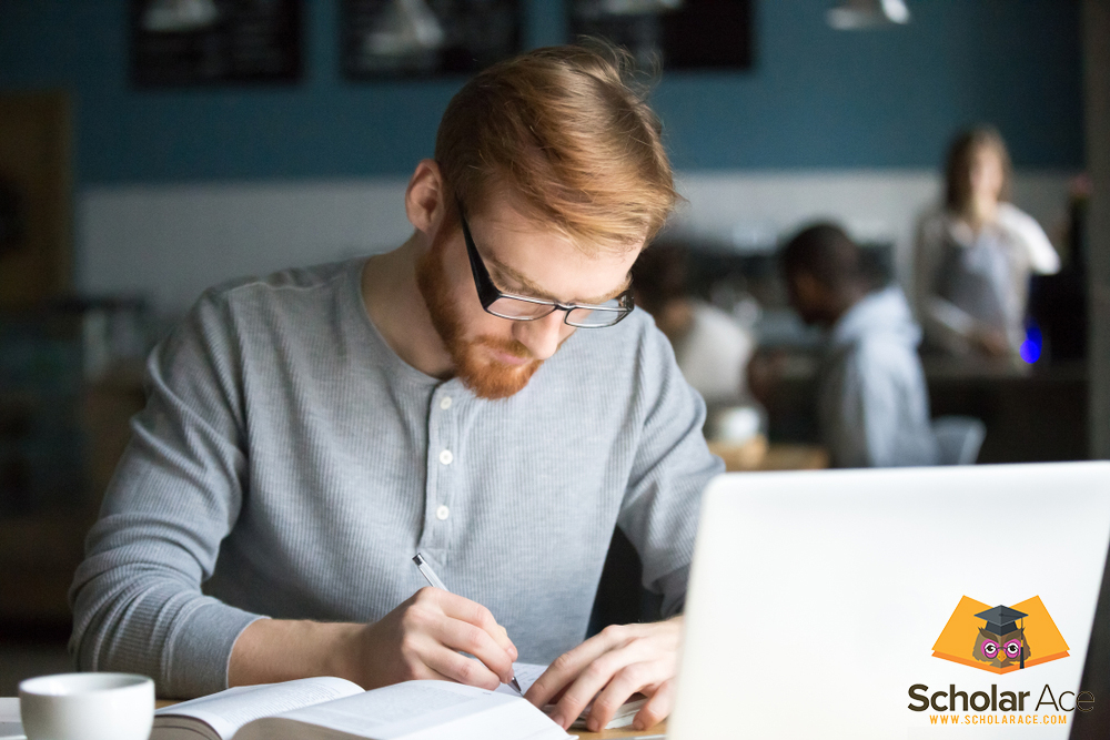 Man writing tips on notepad about essay writing