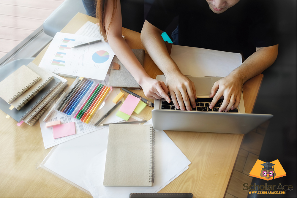 girl helping to writing academic paper on laptop