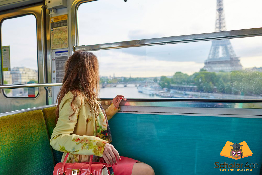 student going in train in front of Eiffel tower